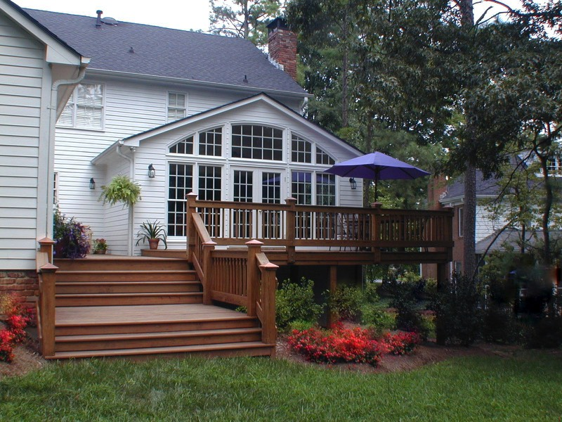 Add windows and French doors to improve flow onto deck