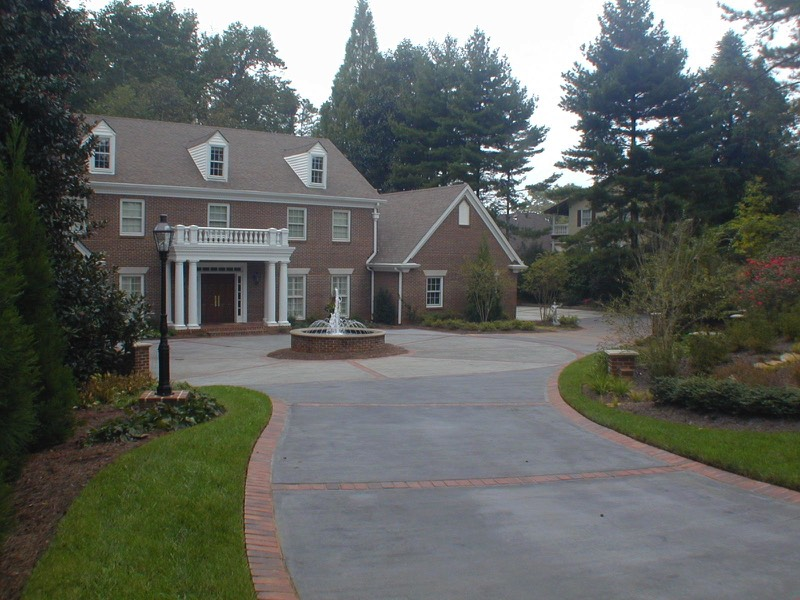 Brick Border Colored Concrete Driveway