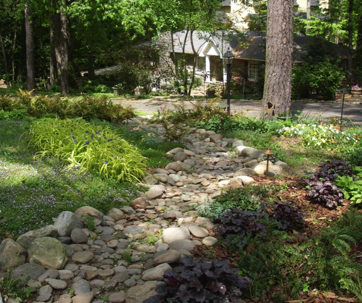 Innovative dry creek beds and drainage solutions for Dry garden designs