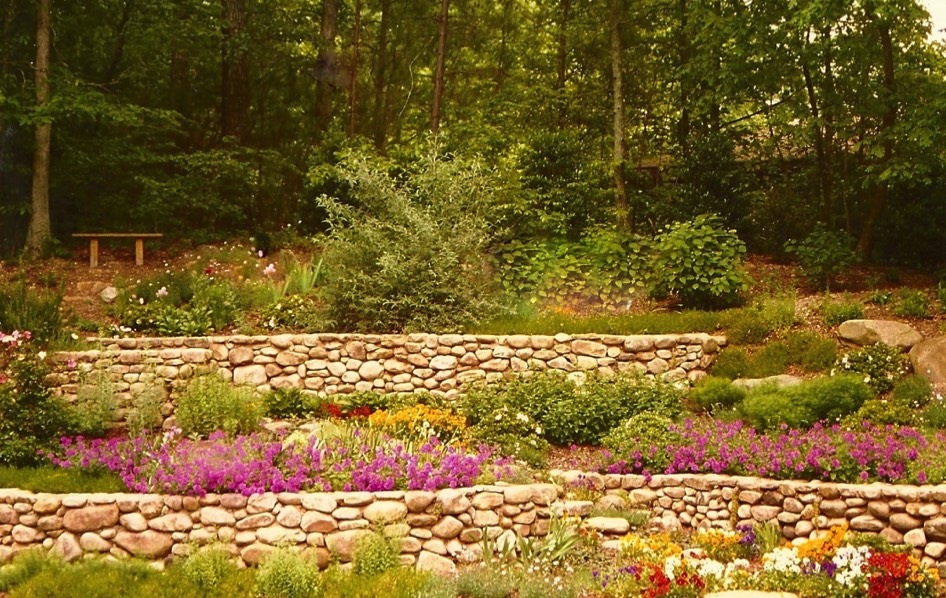 River rock stone wall terraces perennials