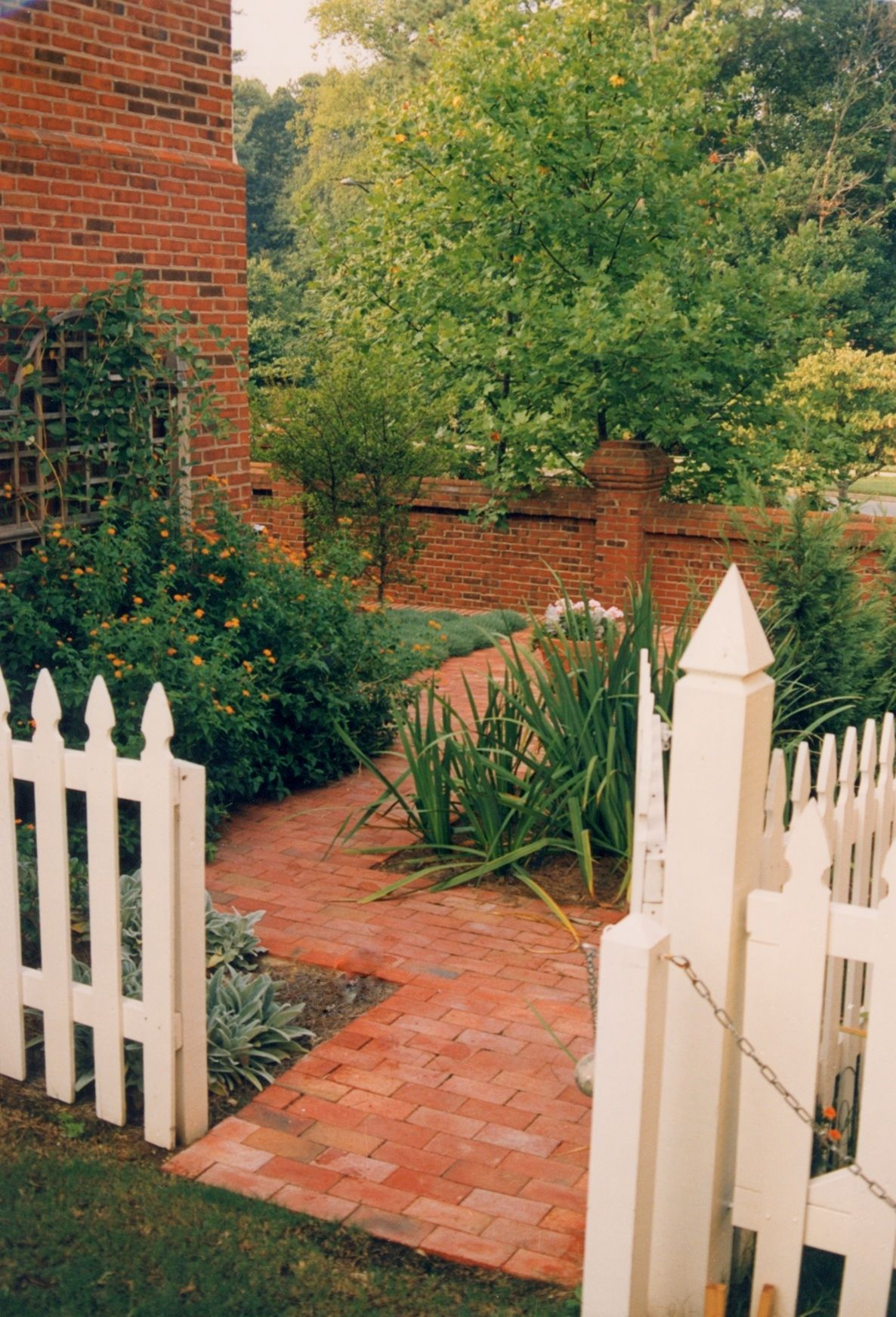 Picket fence brick walk side yard