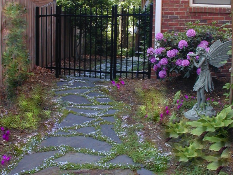 Shady side garden iron gate