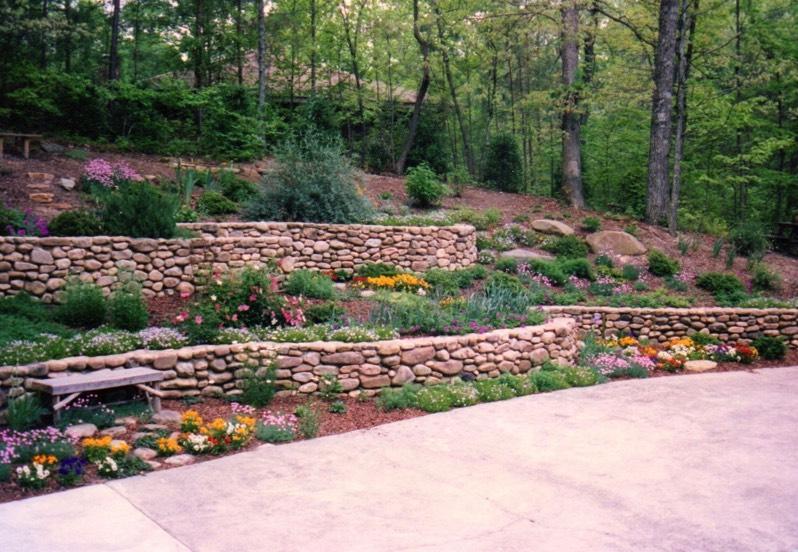 rock wall garden designs. Serpentine river rock walls bolders Walls terraces pretty planter boxes seating terraced