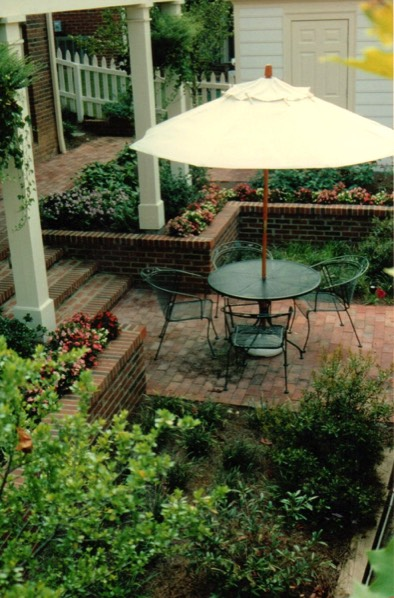 Terraced sunken brick courtyard